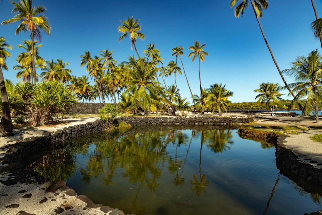 Fish Ponds and Visitor at Pu'uhonua O Honuanua Heiau National Historical Site Big Island Hawaii