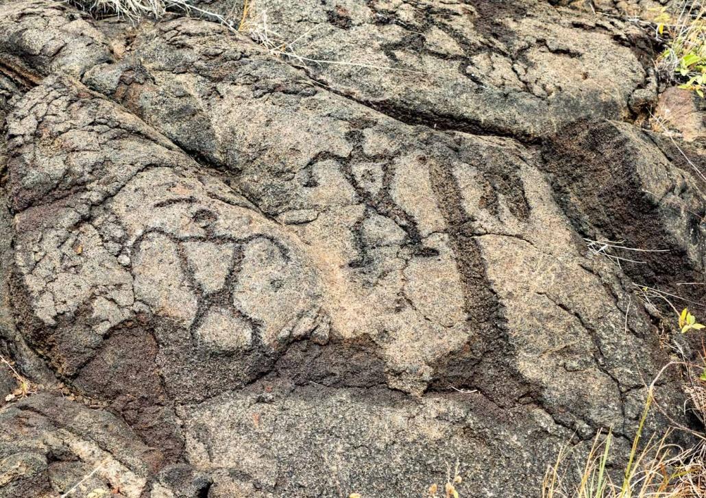 Human figure Petroglyphs at Pu'uloa along Chain of Craters Road Volcanoes National Park Big Island